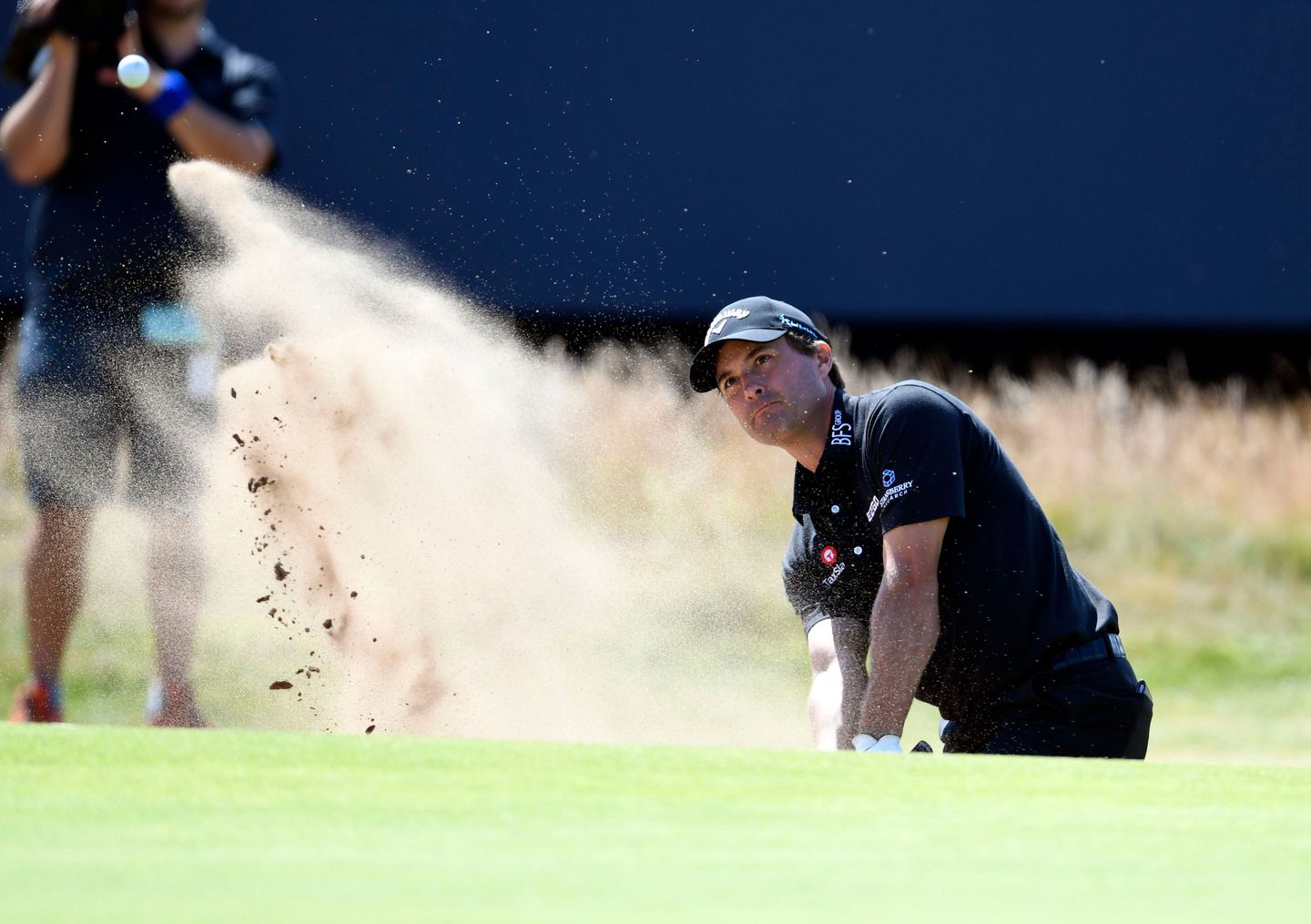 2149cea3f5e66f Kevin Kisner blasts out of a bunker during his first-round 5-under 66