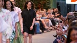 Providence designer Jess Abernethy, in black, smiles to the crowd at the end of her runway show at the StyleWeek Northeast fashion show at the Capital Grille in Providence on June 10, 2021.