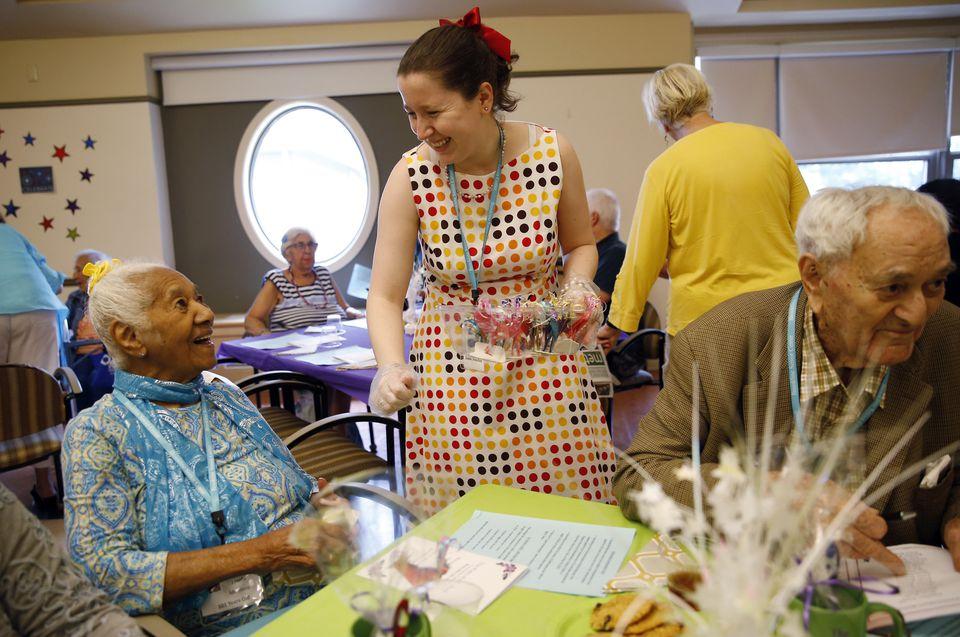 Josefa Montero, 101, received an origami bird from Jamie Donchin.