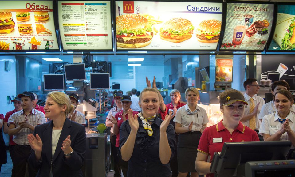 McDonald's staff members celebrate after the fast-food restaurant reopened after being closed for health violations in  November.