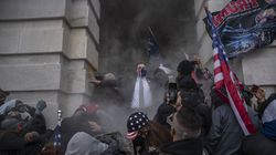 Demonstrators attempt to breach the US Capitol after they earlier stormed the building in Washington, D.C., on Jan. 6, 2021.