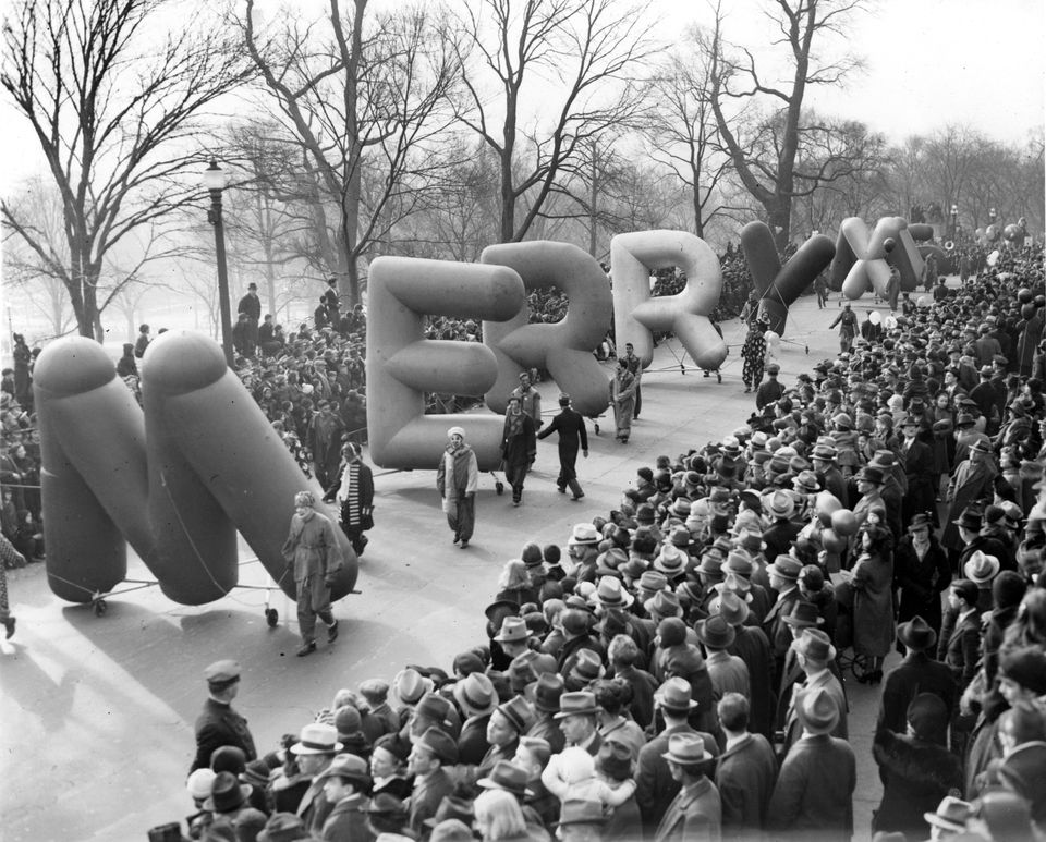 """Balloons spelling out """"Merry Xmas"""" were carried along the Santason parade route in Boston on Thanksgiving Day, Nov. 30, 1939."""