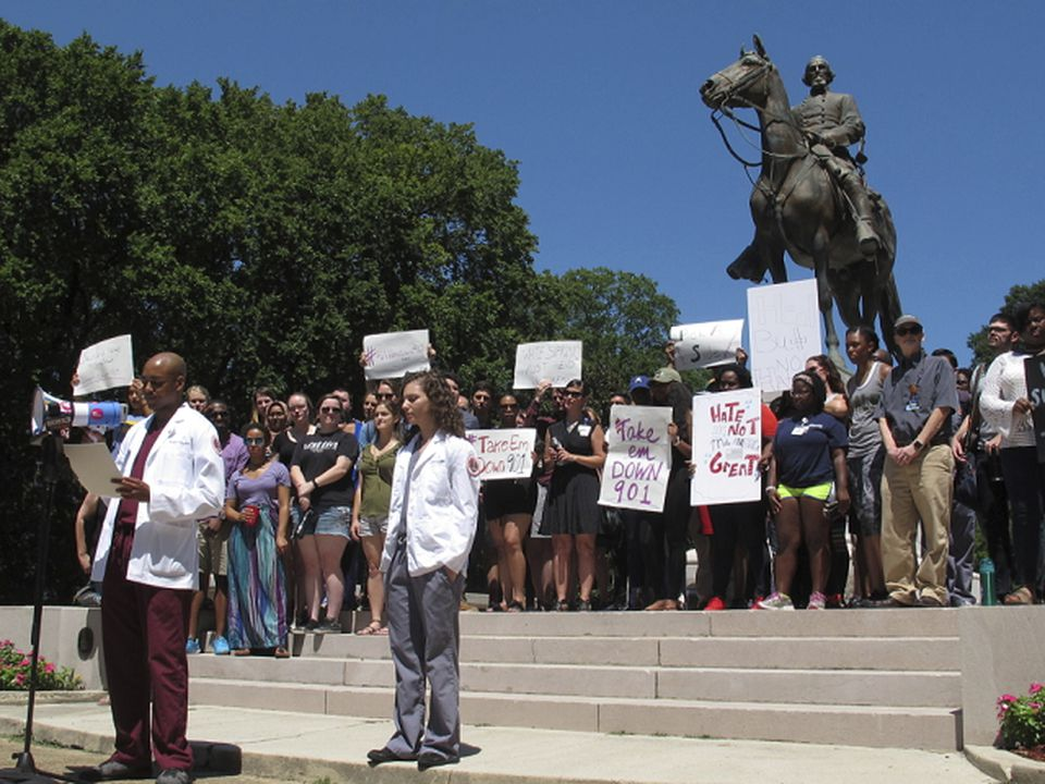 Medical, dental, and nursing students who attend the University of Tennessee's Health Sciences school rallied for the removal of a statue of Confederate general and early Ku Klux Klan leader Nathan Bedford Forrest from a city park, on Aug. 18, in Memphis.