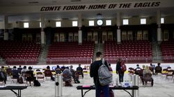 Students waited for 15 minutes in a socially distanced observation area after receiving the Pfizer-BioNTech COVID-19 vaccine inside Boston College's Conte Forum. BC is among the New England schools requiring students to be vaccinated before returning to campus in the fall.