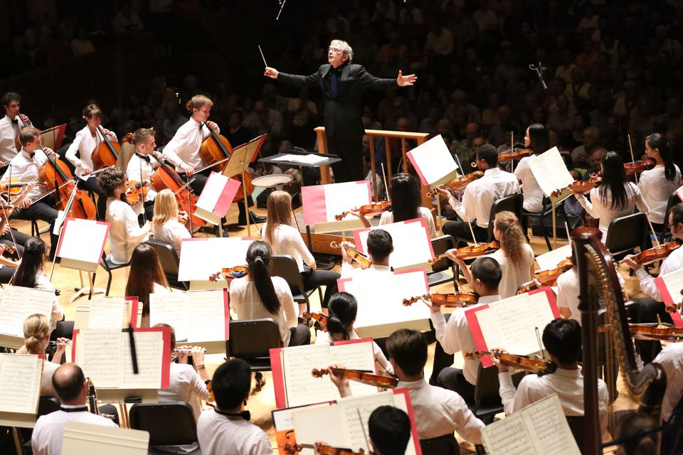 Michael Tilson Thomas leading the TMC Orchestra in Ozawa Hall.