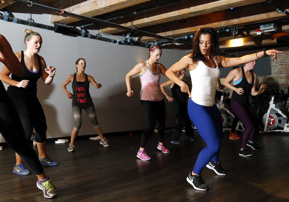 "Kelly Brabants, right, leads her ""Booty by Brabants"" class at The Club by George Foreman III gym in Boston in October."