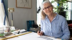Artist Faith Wilding poses for a photo while working on a new drawing in her home studio in Providence.