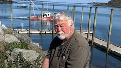Rusty Jackson, 71, sits near near the Lubec harbor in Maine. Jackson said he was vaccinated not just for COVID-19 but for the flu as well.