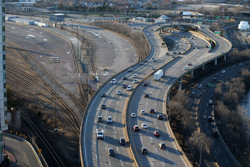 An aerial view of the Mass. Pike. The Beacon Park Yard in Allston can be seen to the left.