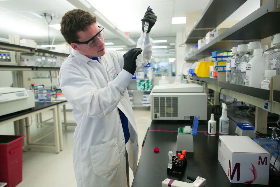 Conor Flaherty works in the lab at Moderna Therapeutics in 2015.
