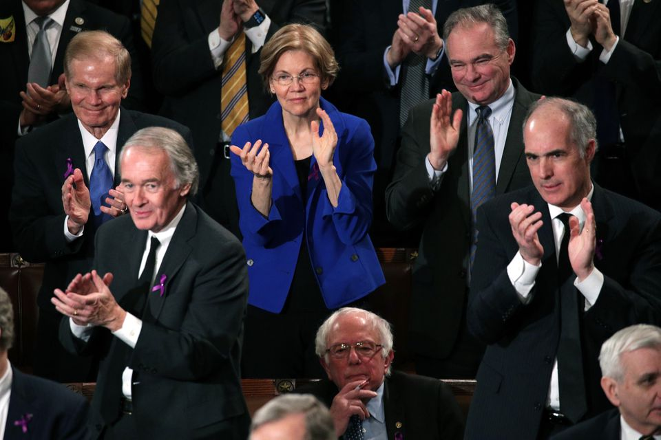 Senators Elizabeth Warren (back row, center) and Ed Markey (front row, left), Democrats of Massachusetts, clap with other senators during the State of the Union.