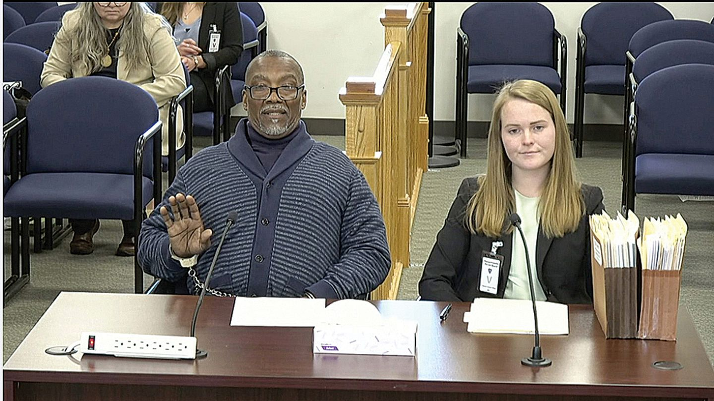 Kent Tyler (left), accompanied by a student attorney at a parole board hearing in January.
