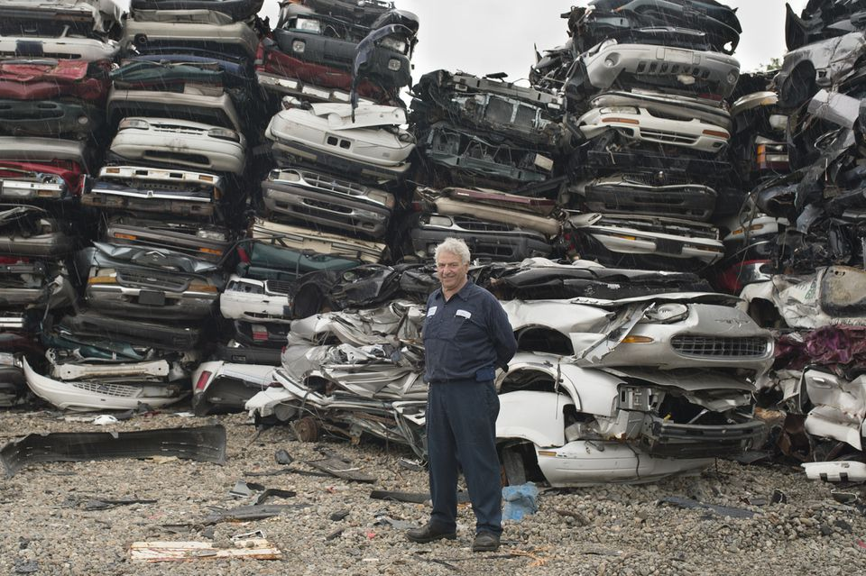Joe Nissebaum of Nissenbaum's Used Auto Parts in his salvage yard, which has been owned and operated by the same family since 1910.