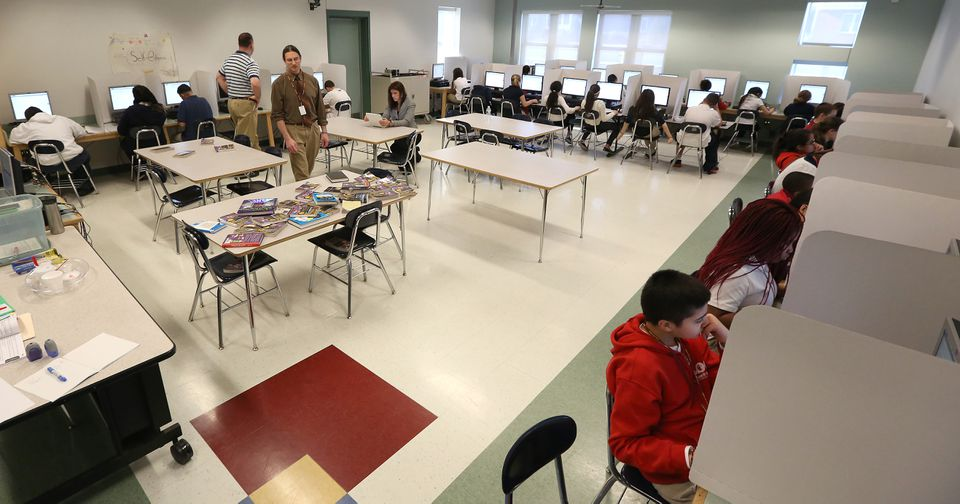 Students in Revere tried the online PARCC test in 2014. Massachusetts officials are looking to broaden the way schools are judged, moving beyond test scores and graduation rates to other measures.