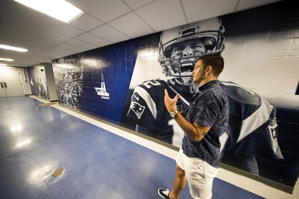 Rowe crosses paths with Tom Brady — or at least a mural of Brady.