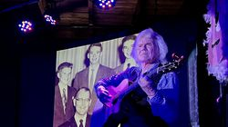 Performer John Davidson sings in front of an old family photo at Club Sandwich, a club he opened this summer in Sandwich, N.H.