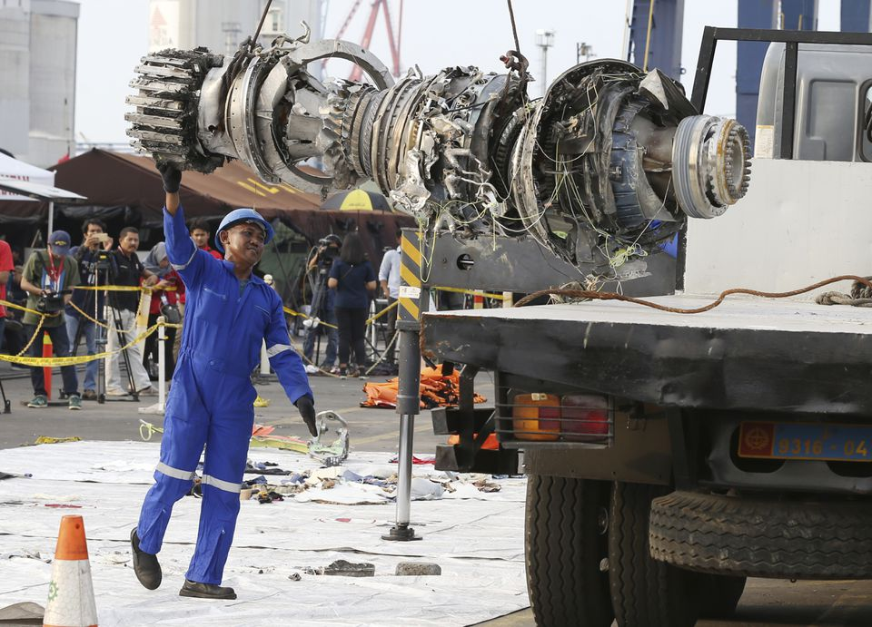 An official moved a recovered engine from the Lion Air jet that crashed in October for further investigation in Indonesia.