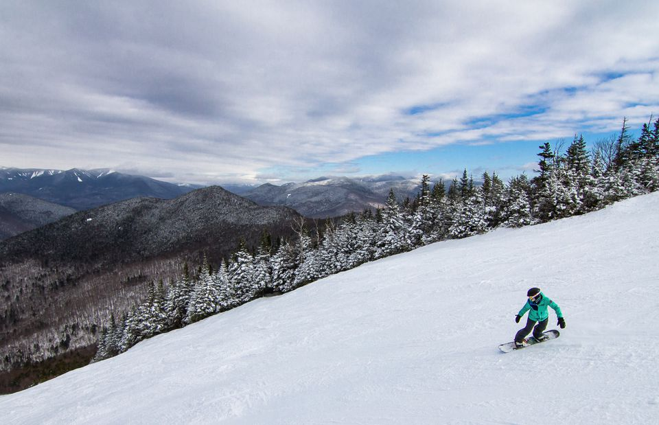 A snowboarder on the upper portion of Walking Boss at Loon.