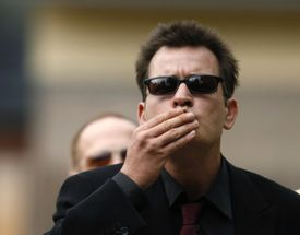 Winning: Actor Charlie Sheen greeted fans as he arrived at a Colorado courthouse.