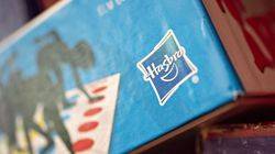 A logo is displayed on a Hasbro Inc. Twister brand game box in an arranged photograph in Tiskilwa, Illinois, U.S., on Saturday, July 21, 2018.