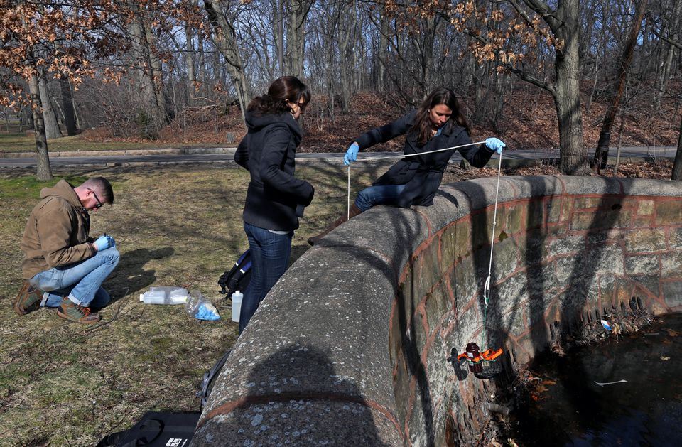From left, interns Richard Treanor and Bethany Perkins helped Elisabeth Cianciola, a  Charles River Watershed Association scientist, test water from Willow Pond in Boston.