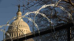 Concertina razor wire tops the 8-foot 'non-scalable' fence that surrounds the U.S. Capitol the day after the House of Representatives voted to impeach President Donald Trump for the second time January 14, 2021 in Washington, DC.
