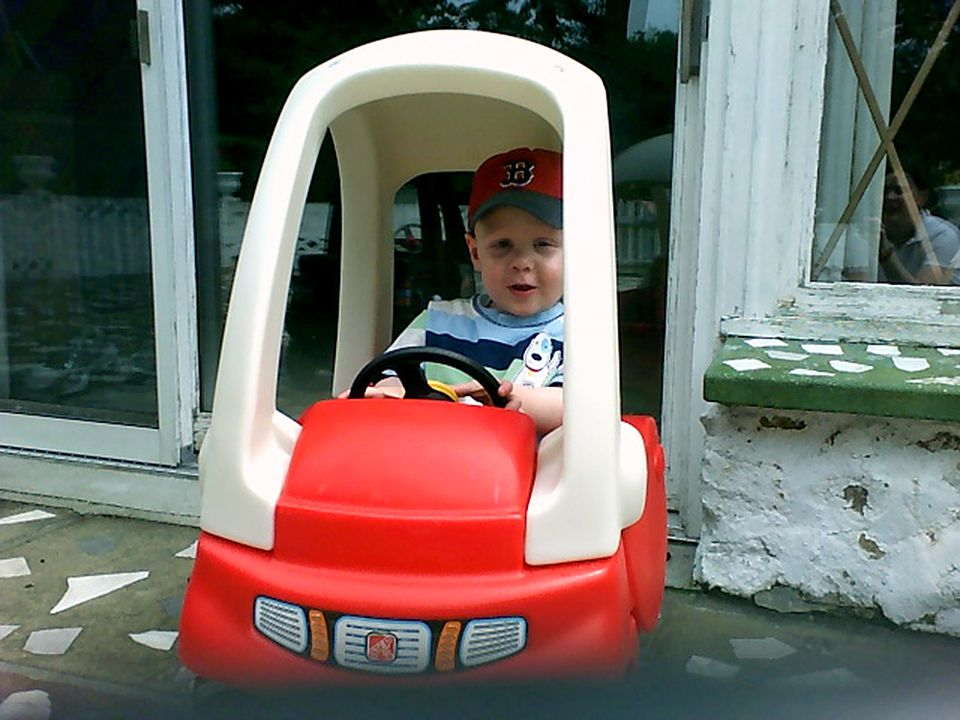 Will driving a toy car while visiting his grandparents in Rhode Island in July 2006.