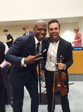 Honoree Terry Crews (left) with prize-winner Pedro Piqueras.
