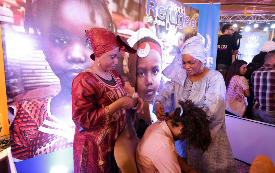 Somali refugees braided hair at a World Refugee Day event in Damascus, Syria this week. Massachusetts lawmakers are working to reduce barriers in the state to hair braiders, who are mostly African-American women and women of African and Caribbean descent.