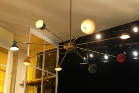 The 8-foot-wide chandelier was made by properties master Kristine Holmes using borrowed lampshades.
