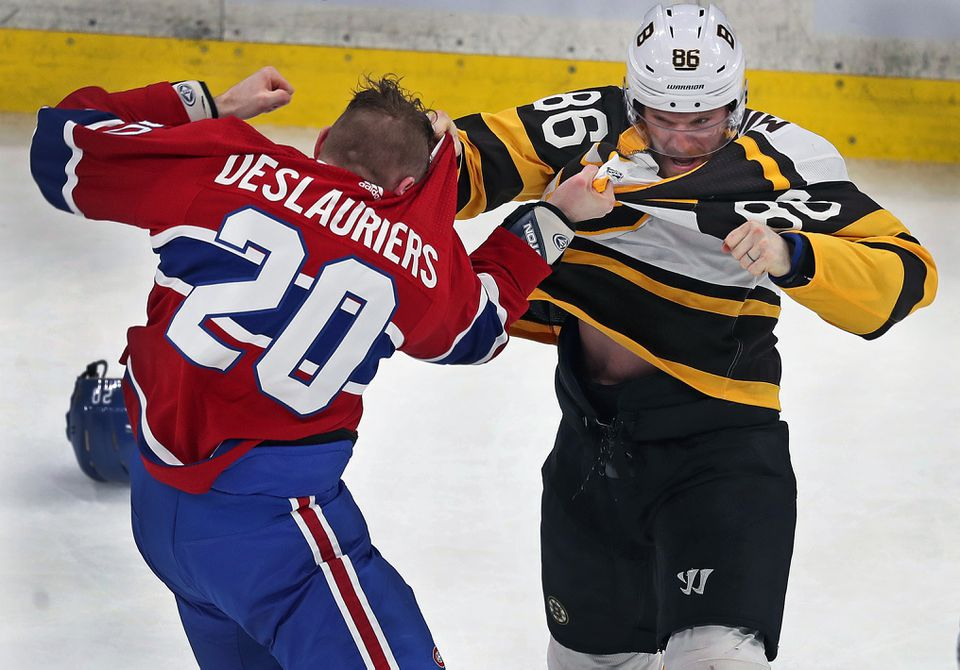The Bruins' Kevan Miller (left) and the Canadiens' Nicolas Deslauriers went toe to toe in the first period.