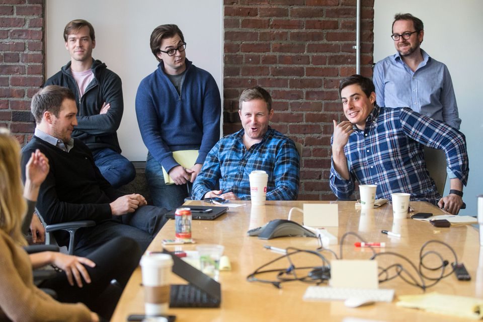 Cofounders Patrick Petitti and Rob Biederman (from left, in check shirts) during a meeting  at HourlyNerd, now Catalant.