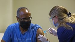 Michael Davis, of Medford, got his first Moderna COVID-19 vaccine dose last month from medical assistant Adriana Boudreau in the Family Practice Group doctor's office in Arlington.