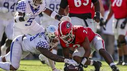 Georgia running back Kendall Milton (2) recovers a fumble as Kentucky linebacker Jacquez Jones battles for the ball during the first half Saturday's matchup of SEC unbeatens in Athens, Ga.