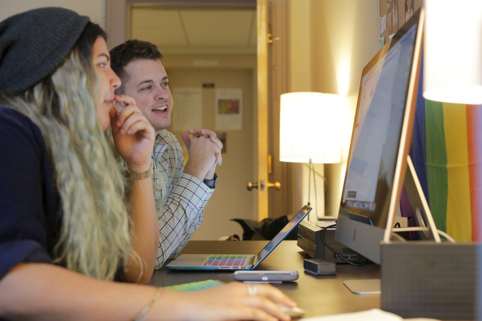 From left: Student Catarina-Oliva Beal with assistant professor K.J. Rawson in the Digital Transgender Archive (DTA) Lab at College of the Holy Cross.