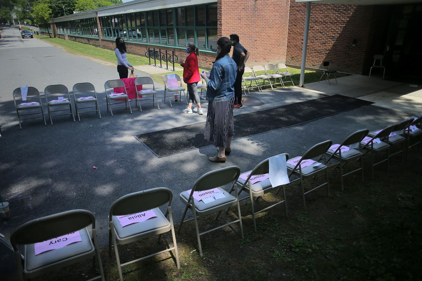 High schoolers organized a protest at the Heath School in Brookline last week. Signs listed the names of teachers who had received pink slips.