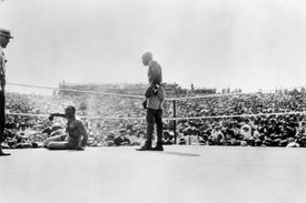 Jack Johnson stands over Jim Jeffries after knocking him down during their bout on July 4, 1910 in Reno.