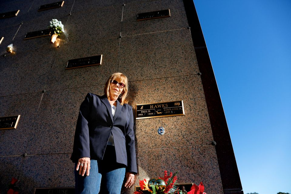 Lorraine Hawks, seen at her late husband's crypt in Tampa, contends that he was led to believe his brother-in-law had a chance at a long life with the liver donation.