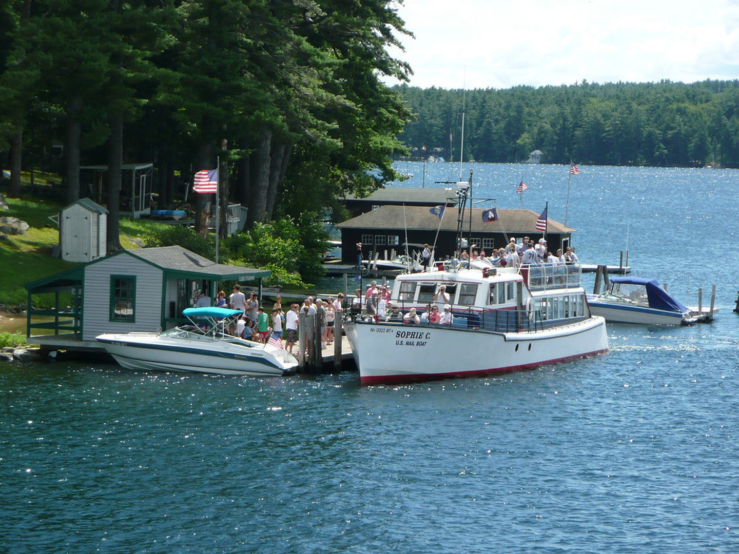 The mail boat Sophie C. on a delivery to Bear Island in Lake Winnipesaukee.