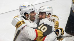 Vegas Golden Knights' Nicolas Roy (right) celebrates his game-winning goal against the Montreal Canadiens with teammate Max Pacioretty in overtime of Game 4.