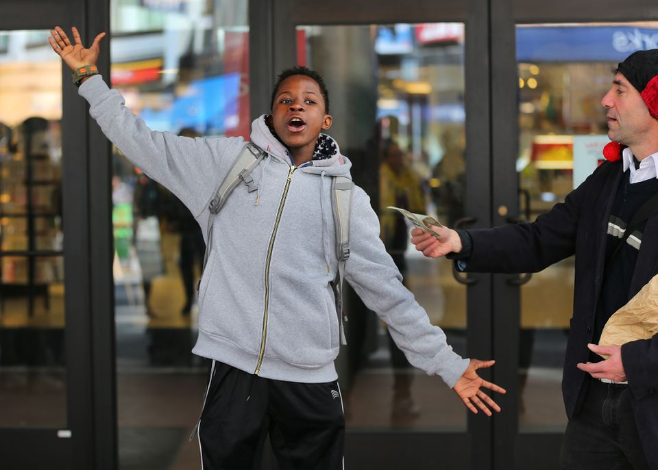 Reneil Miller, 15 from Boston did a short performance to earn his dollar from Alex Feldman.