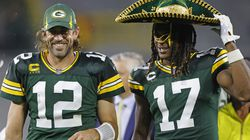 Aaron Rodgers (left) puts on a sombrero on Davante Adams, who had eight catches for 121 yards.