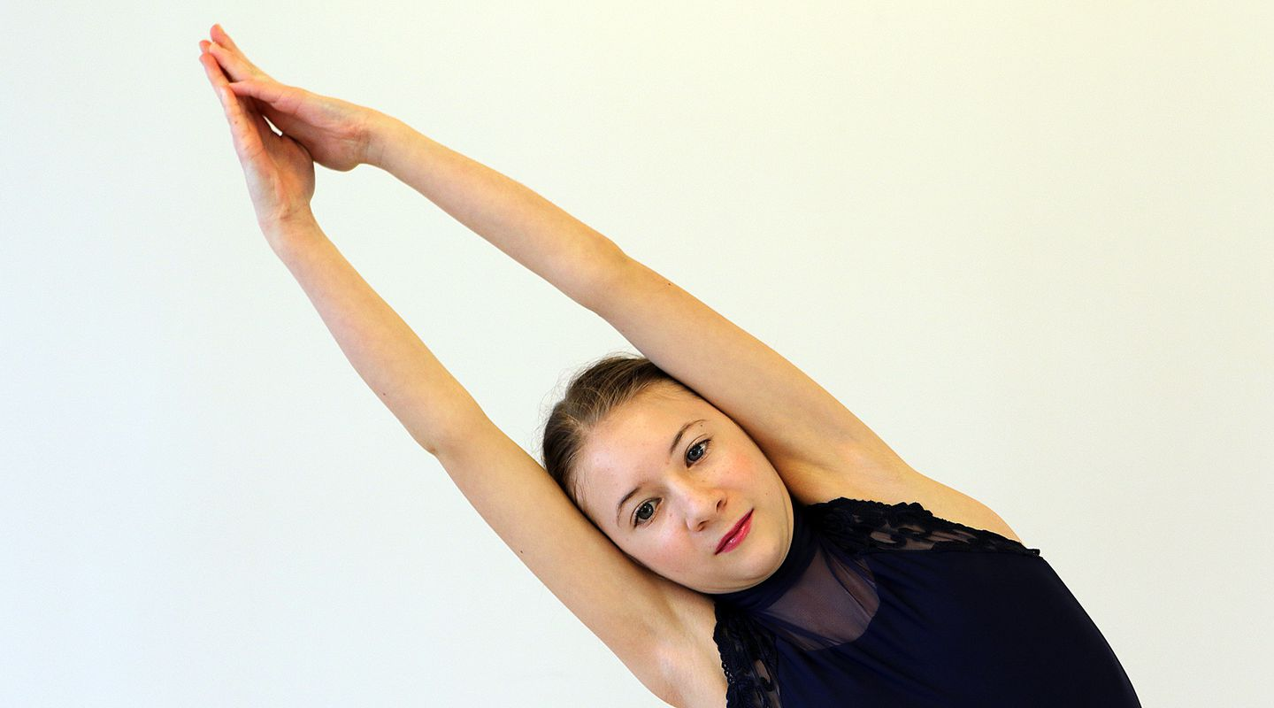 Avery LeMay, 12, warmed up before practicing her yoga routine for an upcoming competition.