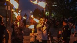 Barbara Papitto, right, and Arnell Milhouse of The Papitto Opportunity Connection  prepare to light a special Waterfire to promote and celebrate BIPOC residents, with music and performances by BIPOC in Providence, R.I. on Saturday, October 16 2021. (Photo/Joe Giblin)