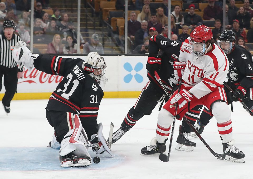 Northeastern goalie Cayden Primeau turns aside BU's Patrick Curry during the first period Monday at TD Garden.