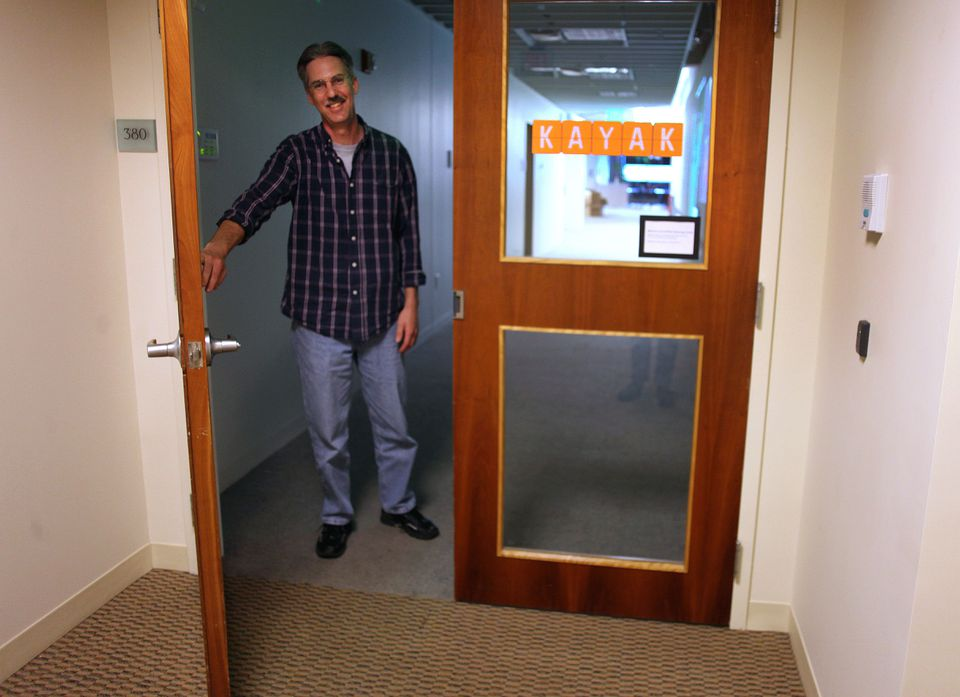 Paul Schwenk, senior vice president of engineering for the Web travel site Kayak, opened the door to the company's offices in Concord, where visitors use a call button to get buzzed in.