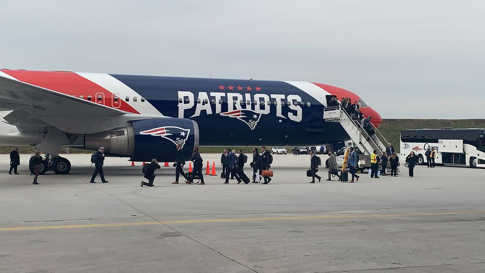 After arriving in Atlanta, the Patriots made their way off their team plane on Sunday.