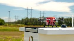 A photo of American Robotics drone system in a field.