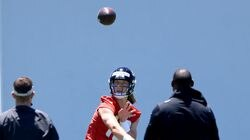 Jacksonville Jaguars rookie quarterback Trevor Lawrence participates in drills during rookie minicamp at TIAA Bank Field in Jacksonville, Fla.