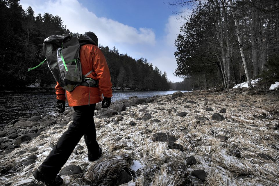 Russell Walters of Carrabasset Valley, Maine walked the shore of the Kennebec River in West Forks, Maine. Walters was showing visitors the area where a plan would bring new high-voltage transmission lines across the Kennebec River Gorge.